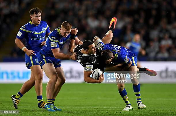 Carlos Tuimavave of Hull is tackled by Daryl Clark of Warrington during the First Utility Super League match between Hull FC and Warrington Wolves at...