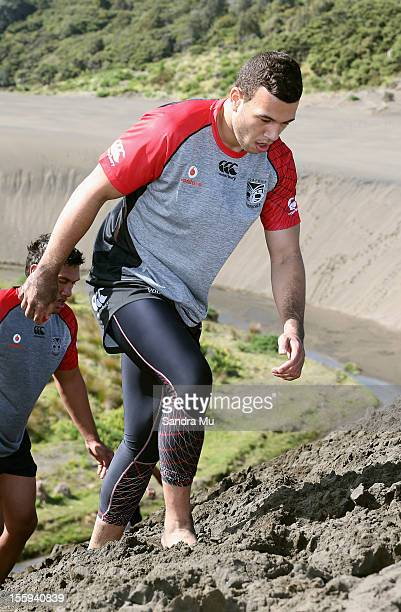 Carlos Tuimavave of the Warriors trains on the sand dunes during the New Zealand Warriors NRL training session at Bethells Beach on November 10 2012...