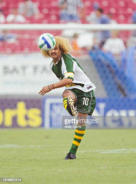 Carlos Valderrama, of Colombia and Midfielder for the Tampa Bay Mutiny strikes the football upfield during the MLS Eastern Conference match against...
