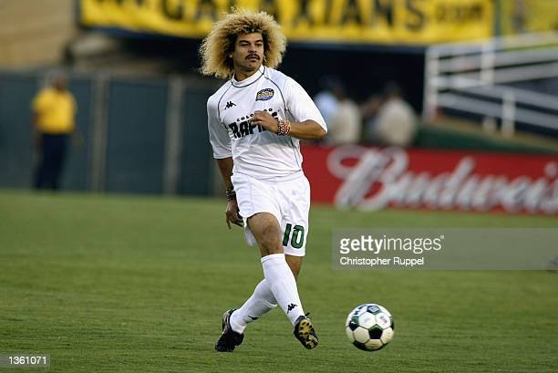 Carlos Valderrama of the Colorado Rapids passes upfield against the Los Angeles Galaxy during the first half on August 17 2002 at the Rose Bowl in...