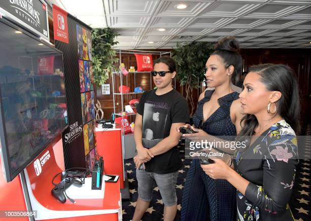 Carlos Valdes Candice Patton and Danielle Nicolet test their skills on Super Smash Bros Ultimate for Nintendo Switch at the Variety Studio at...