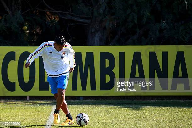 Carlos Valdes of Colombia drives the ball during a training session at San Carlos de Apoquindo training camp on June 13 2015 in Santiago Chile...