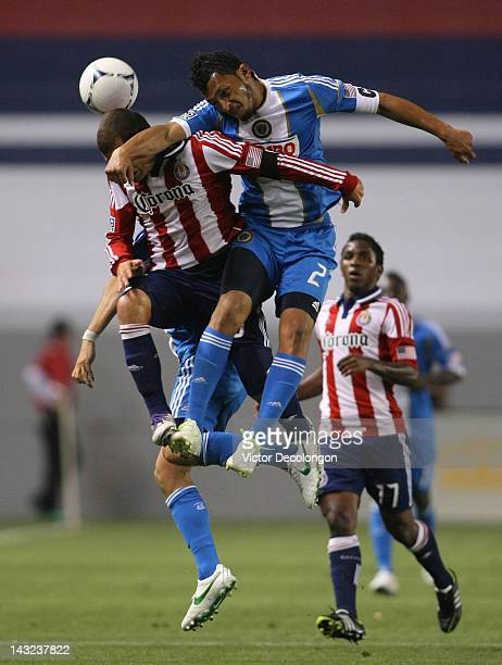 Carlos Valdes of Philadelphia Union and Alejandro Moreno of Chivas USA vie for a high ball in the second half of their MLS match at The Home Depot...