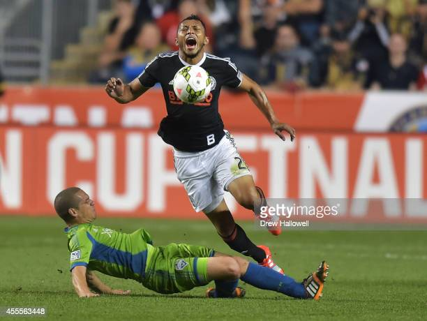 Carlos Valdes of the Philadelphia Union gets tackled by midfielder Osvaldo Alonso of the Seattle Sounders FC during the 2014 US Open Cup Final at PPL...