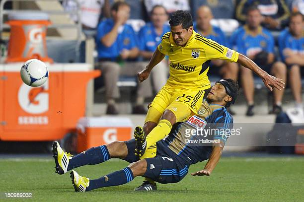 Carlos Valdes of the Philadelphia Union slides into the legs of Jairo Arrieta of the Columbus Crew at PPL Park on August 29 2012 in Chester...