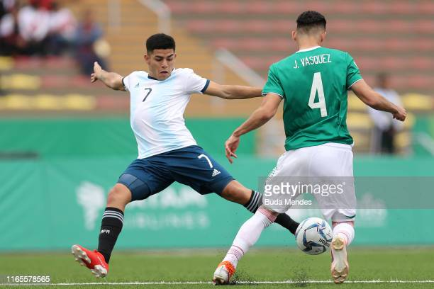 Carlos Valenzuela of Argentina fights for the ball with Johan Felipe Vasquez of Mexico during Men´s football First Round Group A match between Mexico...