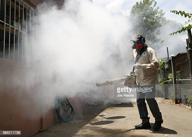 Carlos Varas a MiamiDade County mosquito control inspector uses a Golden Eagle blower to spray pesticide to kill mosquitos in the Wynwood...