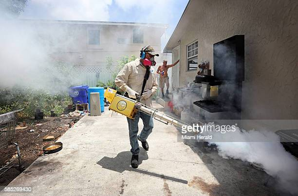 Carlos Varas a MiamiDade County mosquito inspector sprays around homes in the Wynwood area of Miami on Tuesday Aug 2 as 14 cases of Zika have been...