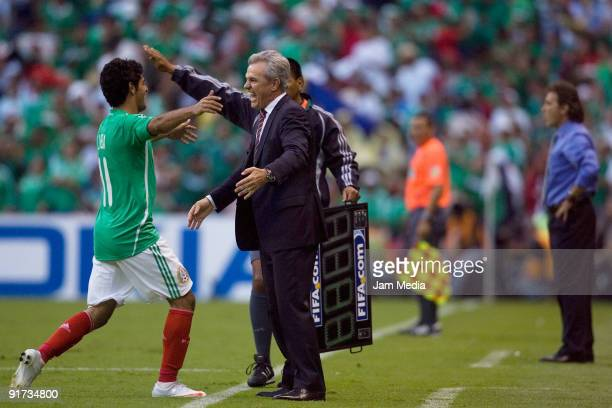 Carlos Vela and Head Coach Javier Aguirre of Mexico celebrate scored goal during a 2010 FIFA World Cup qualifying at the Azteca Stadium on October...