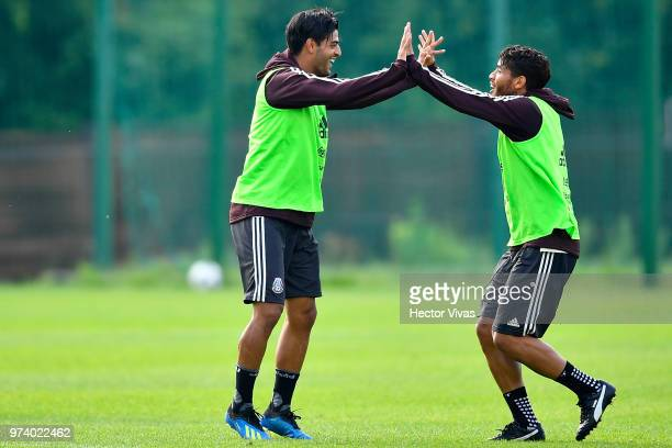 Carlos Vela and Jonathan dos Santos of Mexico celebrate during a training session at FC Strogino Stadium on June 12 2018 in Moscow Russia