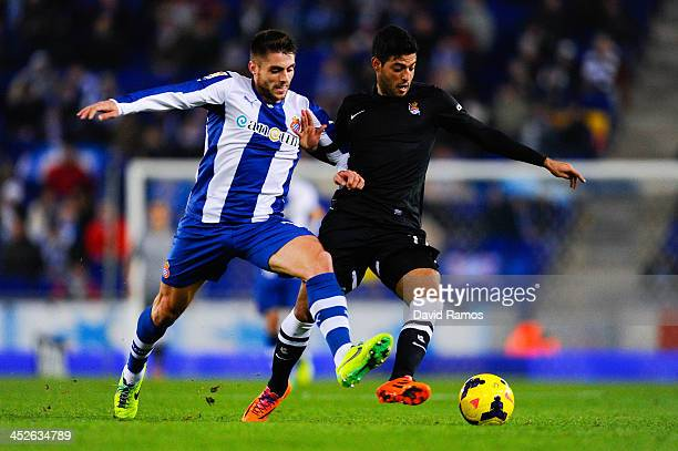 Carlos Vela Garrido of Real Sociedad duels for the ball with David Lopez of RCD Espanyol during the La Liga match between RCD Espanyol and Real...