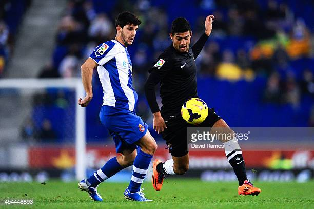 Carlos Vela Garrido of Real Sociedad duels for the ball with Javi Lopez of RCD Espanyol during the La Liga match between RCD Espanyol and Real...