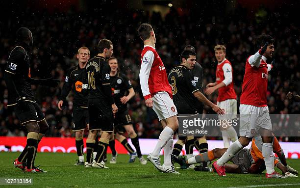 Carlos Vela of Arsenal celebrates as Antolin Alcaraz of Wigan scores an own goal during the Carling Cup quarter final match between Arsenal and Wigan...