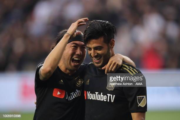 Carlos Vela of LAFC Los Angeles Football Club gets congratulated by Lee Nguyen of LAFC Los Angeles Football Club after scoring a goal to make it 10...