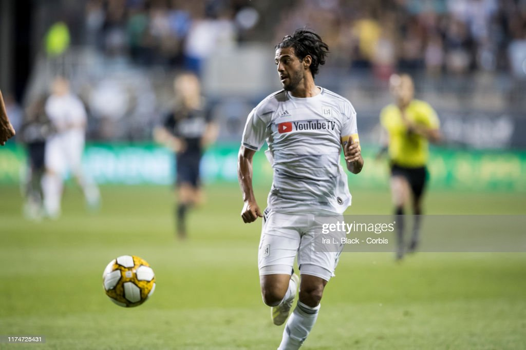 Carlos Vela Of Lafc Tries To Keep The Ball In Front Of Him