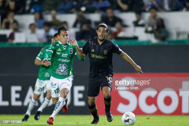 Carlos Vela of LAFC vies for the ball with Ivan Rodriguez of Leon during the round of 16 match between Leon and LAFC as part of the CONCACAF...