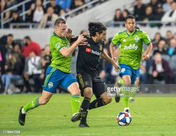 Carlos Vela of Los Angeles FC battles Brad Smith of Seattle Sounders during the MLS Western Conference Final between Los Angeles FC and Seattle...