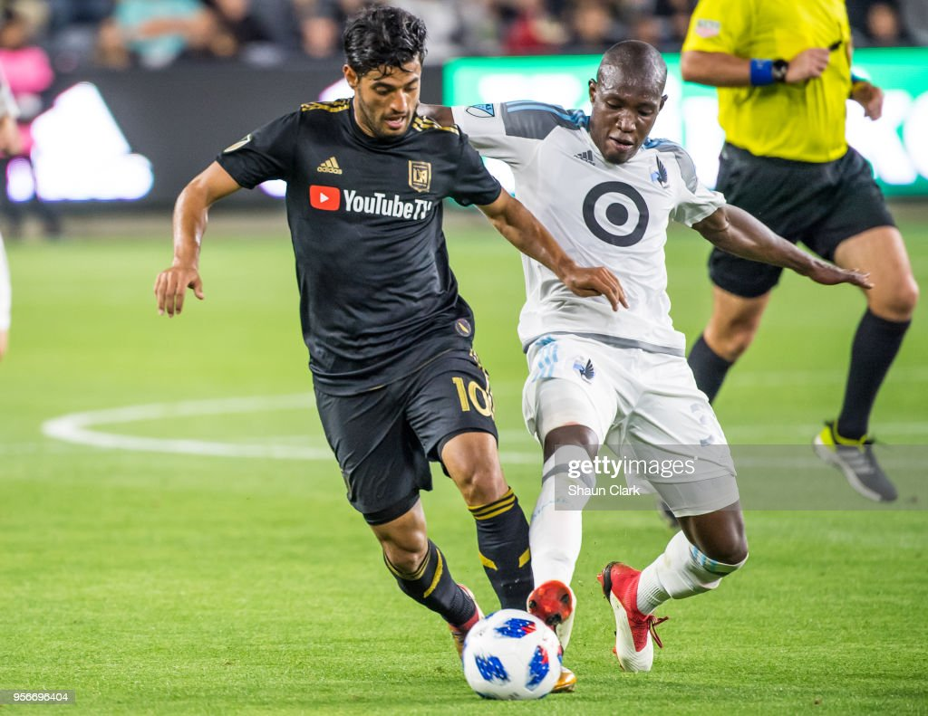 Carlos Vela #10 of Los Angeles FC battles Maximiniano #31 of Minnesota United during Los Angeles FC's MLS match against Minnesota United at the Banc of California Stadium on May 9, 2018 in Los Angeles, California. Los Angeles FC won the match 2-0