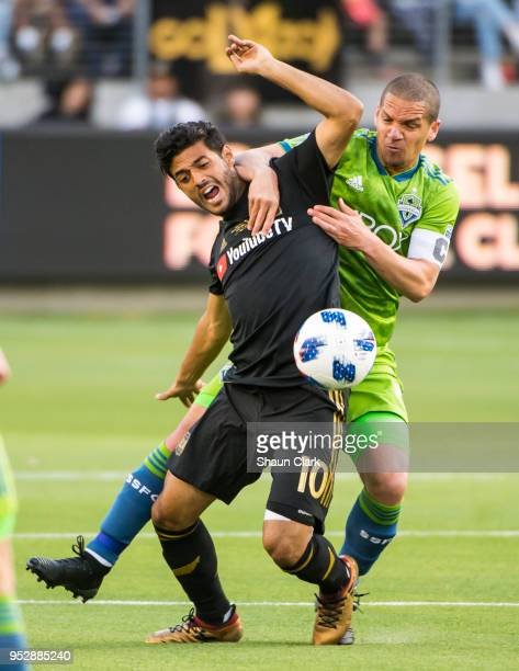 Carlos Vela of Los Angeles FC battles Osvaldo Alonso of Seattle Sounders during Los Angeles FC's MLS match against Seattle Sounders at the Banc of...