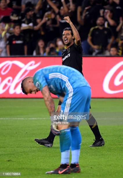 Carlos Vela of Los Angeles FC celebrates his goal behind David Bingham of Los Angeles Galaxy to take a 10 lead during the first half of the Western...