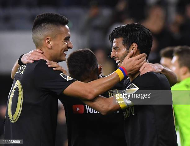 Carlos Vela of Los Angeles FC celebrates his goal to take a 20 lead over FC Cincinnati with Eduard Atuesta and Diego Rossi during a 20 win at Banc of...