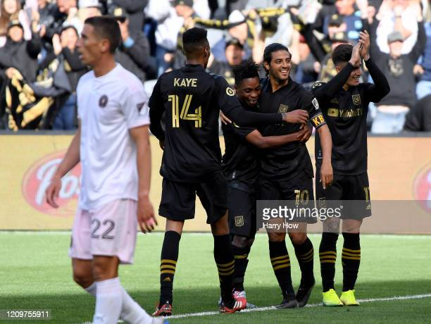 Carlos Vela of Los Angeles FC celebrates his goal with Latif Blessing MarkAnthony Kaye and Jose Cifuentes in front of Ben Sweat of Inter Miami CF to...