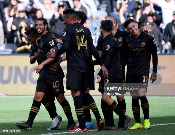 Carlos Vela of Los Angeles FC celebrates his goal with Latif Blessing MarkAnthony Kaye and teammates to take a 11 lead over Inter Miami CF during the...
