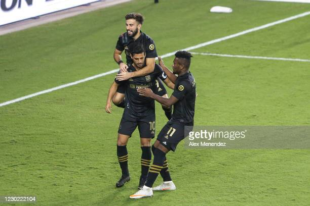 Carlos Vela of Los Angeles FC celebrates with Diego Rossi and Jose Cifuentes after his goal in the second half during the CONCACAF Champions League...