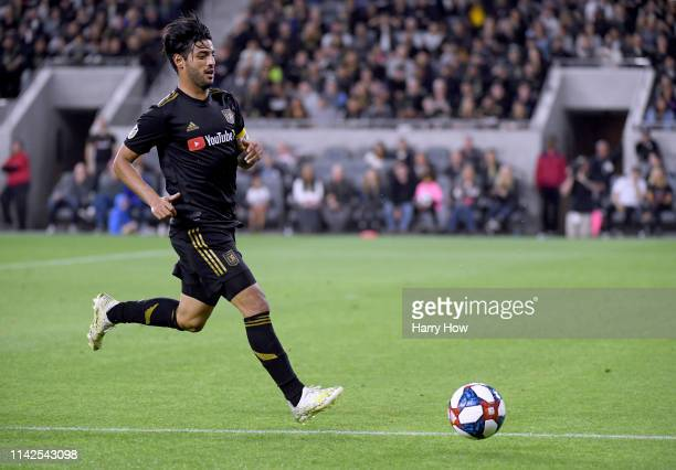Carlos Vela of Los Angeles FC chases down a ball during a 20 win over FC Cincinnati at Banc of California Stadium on April 13 2019 in Los Angeles...