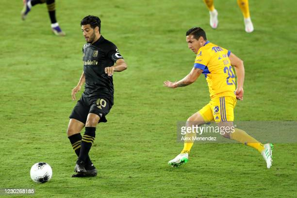 Carlos Vela of Los Angeles FC controls the ball in front of Jesus Duenas of Tigres UANL during the CONCACAF Champions League final game at Exploria...