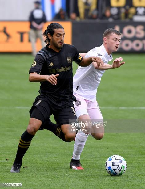 Carlos Vela of Los Angeles FC fends off Matias Pellegrini of Inter Miami CF during the first half at Banc of California Stadium on March 01 2020 in...