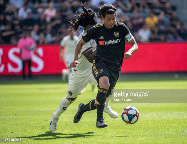 Carlos Vela of Los Angeles FC goes past Lalas Abubakar of Colorado Rapids during Los Angeles FC's MLS match against Sporting Kansas City at the Banc...
