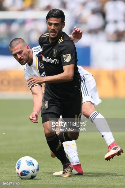 Carlos Vela of Los Angeles FC / LAFC and Perry Kitchen of Los Angeles Galaxy during the MLS match between Los Angeles FC and Los Angeles Galaxy at...