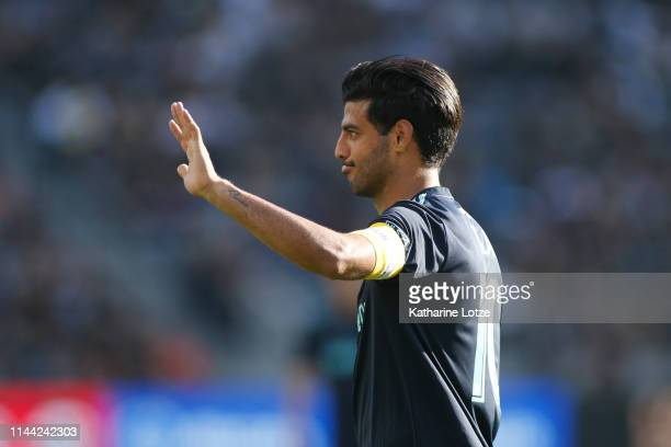 Carlos Vela of Los Angeles FC looks on during a game against the Seattle Sounders at Banc of California Stadium on April 21 2019 in Los Angeles...