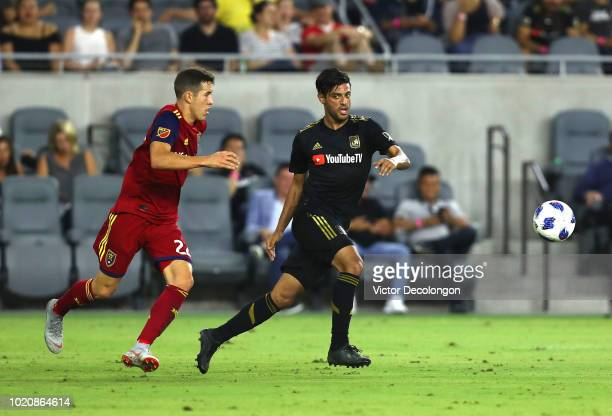 Carlos Vela of Los Angeles FC plays the ball away from Aaron Herrera of Real Salt Lake during the second half of the MLS match at Banc of California...
