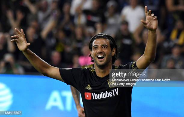 Carlos Vela of Los Angeles FC reacts after scoring his second goal against goalkeeper David Bingham of Los Angeles Galaxy in the first half of a...