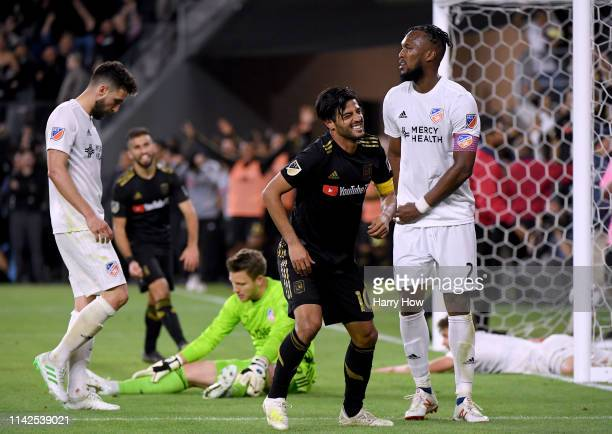 Carlos Vela of Los Angeles FC reacts to his goal in front of Kendall Waston Spencer Richey and Mathieu Deplagne of FC Cincinnati during a 20 win at...