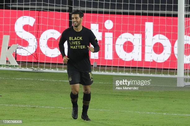 Carlos Vela of Los Angeles FC smiles as he warms up during the CONCACAF Champions League final game against Tigres UANL at Exploria Stadium on...