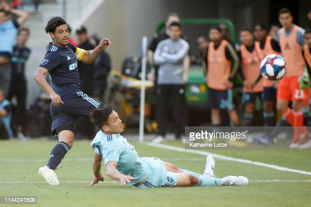 Carlos Vela of Los Angeles FC takes a shot on goal while Kim KeeHee of Seattle Sounders slides to block during the second half of a game at Banc of...