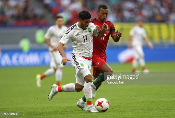 Carlos Vela of Mexico and Nani of Portugal battle for possession during the FIFA Confederations Cup Russia 2017 Group A match between Portugal and...