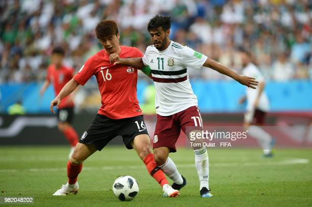 Carlos Vela of Mexico battles for possession with Ki SungYueng of Korea Republic during the 2018 FIFA World Cup Russia group F match between Korea...