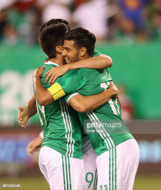 Carlos Vela of Mexico celebrates after scoring with teammate Raul Jimenez during the friendly match between the Republic of Ireland and Mexico at...