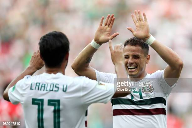 Carlos Vela of Mexico celebrates with teammate Javier Hernandez after scoring a penalty for his team's first goal during the 2018 FIFA World Cup...