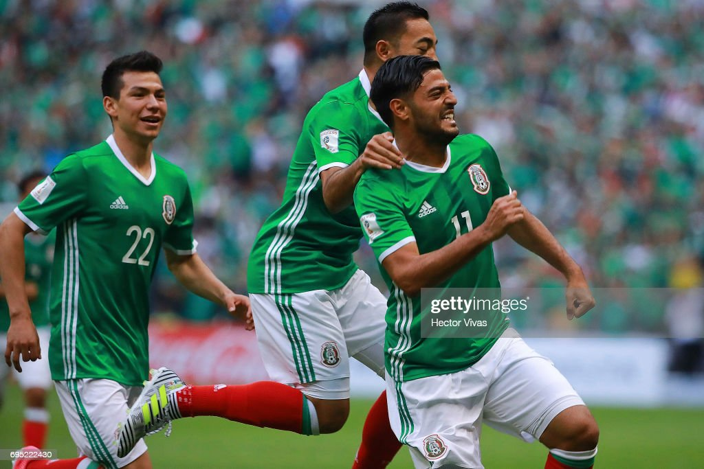Carlos Vela of Mexico celebrates with teammates after during the match between Mexico and The United States as part of the FIFA 2018 World Cup Qualifiers at Azteca Stadium on June 11, 2017 in Mexico City, Mexico.