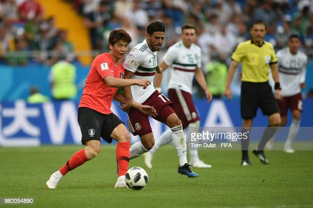 Carlos Vela of Mexico challenges Ki SungYueng of Korea Republic during the 2018 FIFA World Cup Russia group F match between Korea Republic and Mexico...