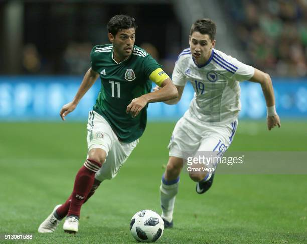 Carlos Vela of Mexico fights for the ball with Luka Menalo of Bosnia and Herzegovina during the friendly match between Mexico and Bosnia and...