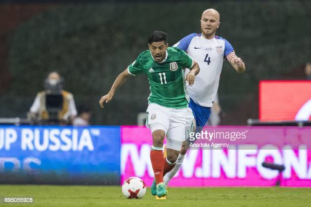 Carlos Vela of Mexico fights for the ball with Michael Bradley of United States during the match between Mexico and United States as part of the FIFA...
