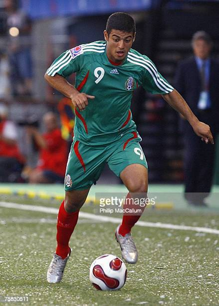 Carlos Vela of Mexico moves the ball on the wing against Argentina in their quarterfinal match of the FIFA U20 2007 World Cup at Frank Clair Stadium...