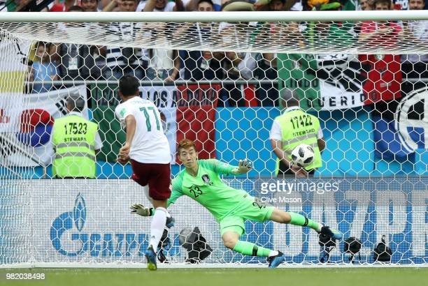Carlos Vela of Mexico scores a penalty for his sides first goal past Hyeonwoo Jo of Korea Republic during the 2018 FIFA World Cup Russia group F...