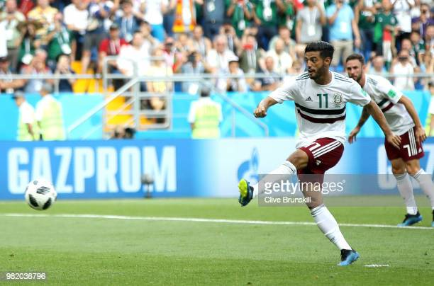 Carlos Vela of Mexico scores his team's first goal from the penalty spot during the 2018 FIFA World Cup Russia group F match between Korea Republic...